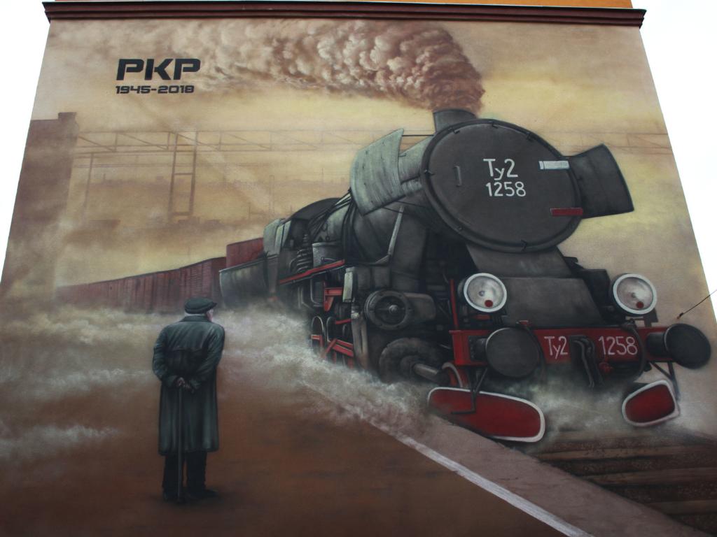 historyczny mural, pkp 1945, wagony towarowe, mural, koncepcja, dymnica, emerytowany kolejarz, sentyment, impresja