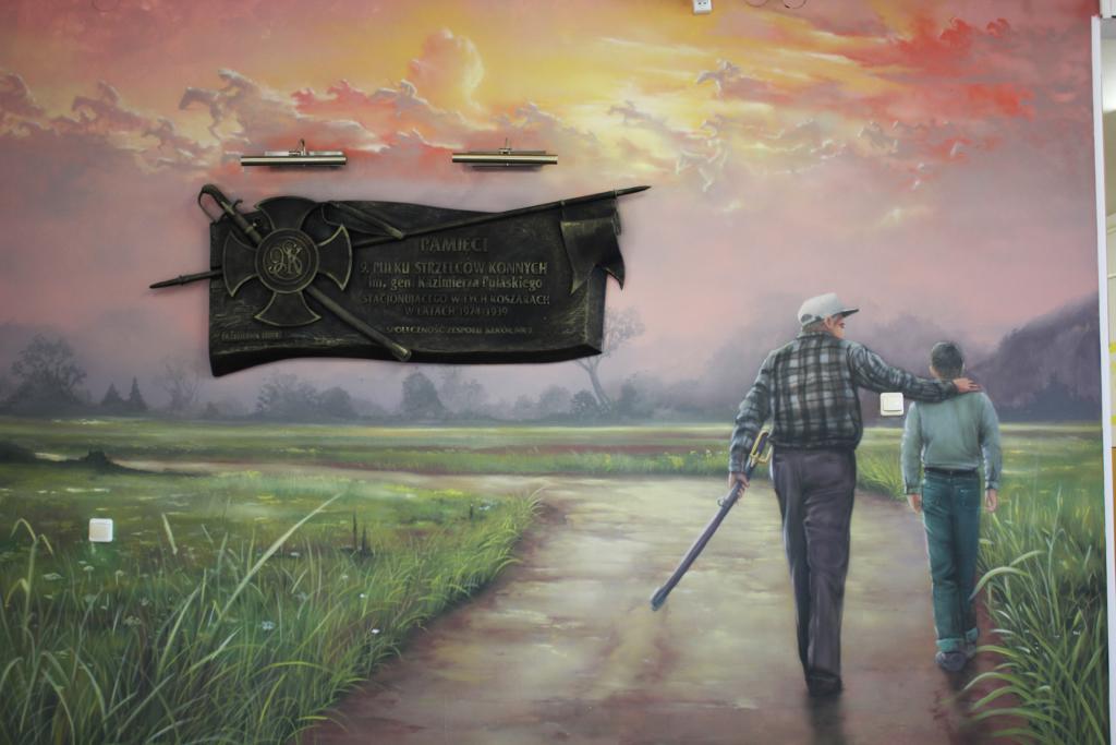 malowidło ścienne przedstawia ułana z wnukiem
